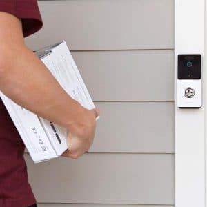 Delivery man walking up to RemoBell Video Doorbell